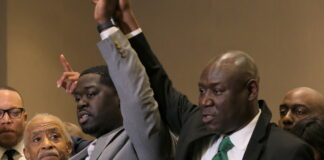 George Floyd's nephew Brandon Williams (left) raises hands in triumph with civil rights attorney Ben Crump after former Minneapolis police officer Derek Chauvin was convicted of murder and manslaughter on April 20, 2021. Photo by Max Nesterak/Minnesota Reformer.