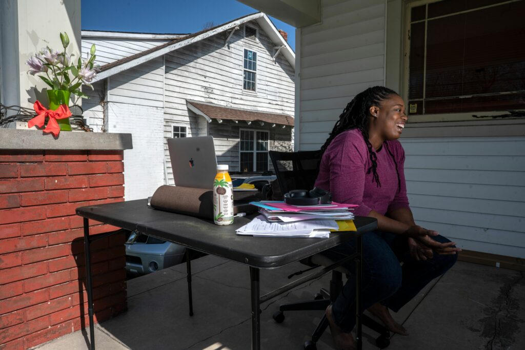 Odessa Kelly works on the porch of her East Nashville. (Photo: John Partipilo)