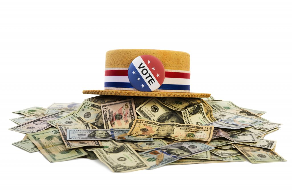 Political hat with money. (Getty Images)