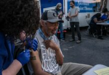 Kevin Hawkins, who is homeless, grimaces as he gets the Johnson and Johnson vaccine from Deanna Hensley, RN, from Ascension/St. Thomas. (Photo: John Partipilo)
