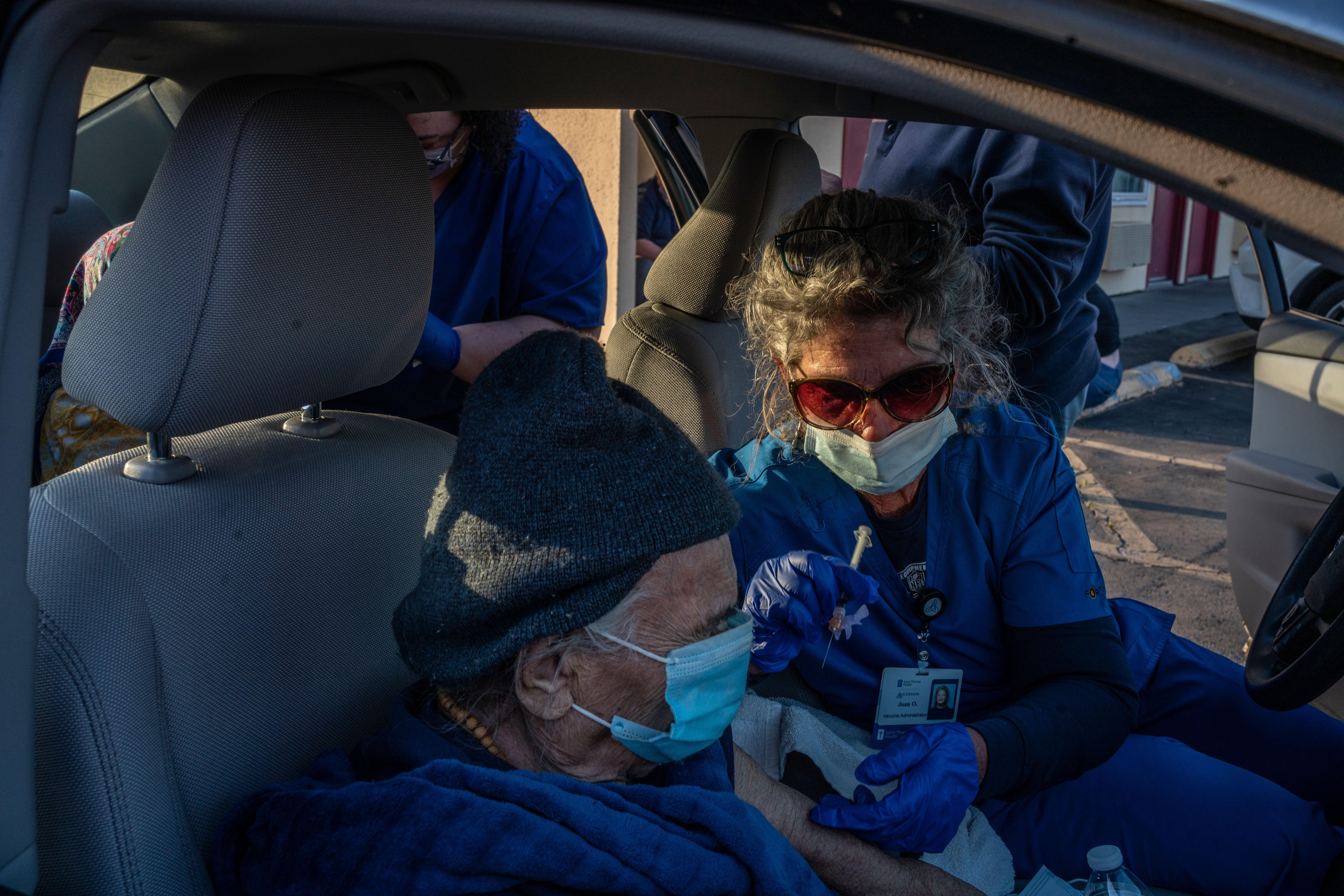 Saggankunver Chudasami 97, get a Johnson and Johnson vaccine in her son's car at a South Nashville Rodeway Inn. (Photo: John Partipilo)