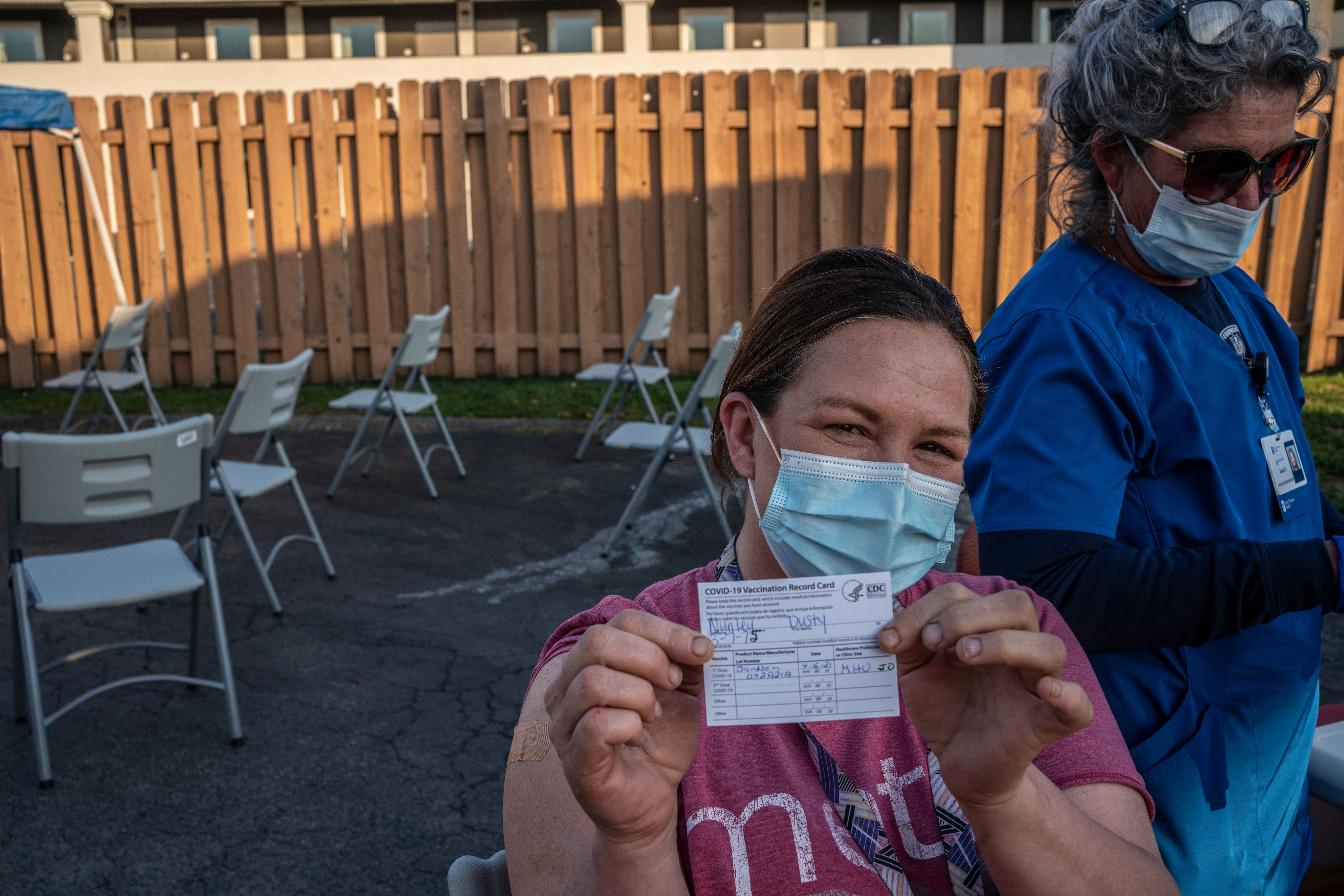 Dusty Nunley was the first person to get vaccinated at the Rodeway Inn during an April mobile clinic for Nashville's homeless and shows off her vaccination card. (Photo: John Partipilo)