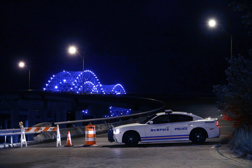 A police car blocks entrance to the Hernando DeSoto Bridge over the Mississippi River in Memphis after a substantial crack was found in it May 11. (Photo: Karen Pulfer Focht)