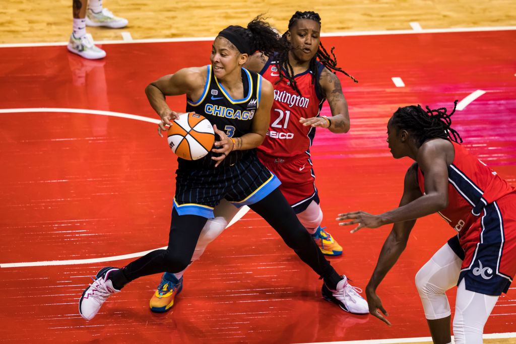 WASHINGTON, DC - MAY 15: Former University of Tennessee Lady Vol Candace Parker, wearing #3 of the Chicago Sky, handles the ball in front of Shavonte Zellous, #21 of the Washington Mystics during the first half at Entertainment Sports Arena on May 15, 2021 in Washington, DC. (Photo by Scott Taetsch/Getty Images)
