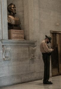 A Tennessee State Trooper stands beside a bust of Confederate Gen. Nathan Bedford Forrest. (Photo: John Partipilo)