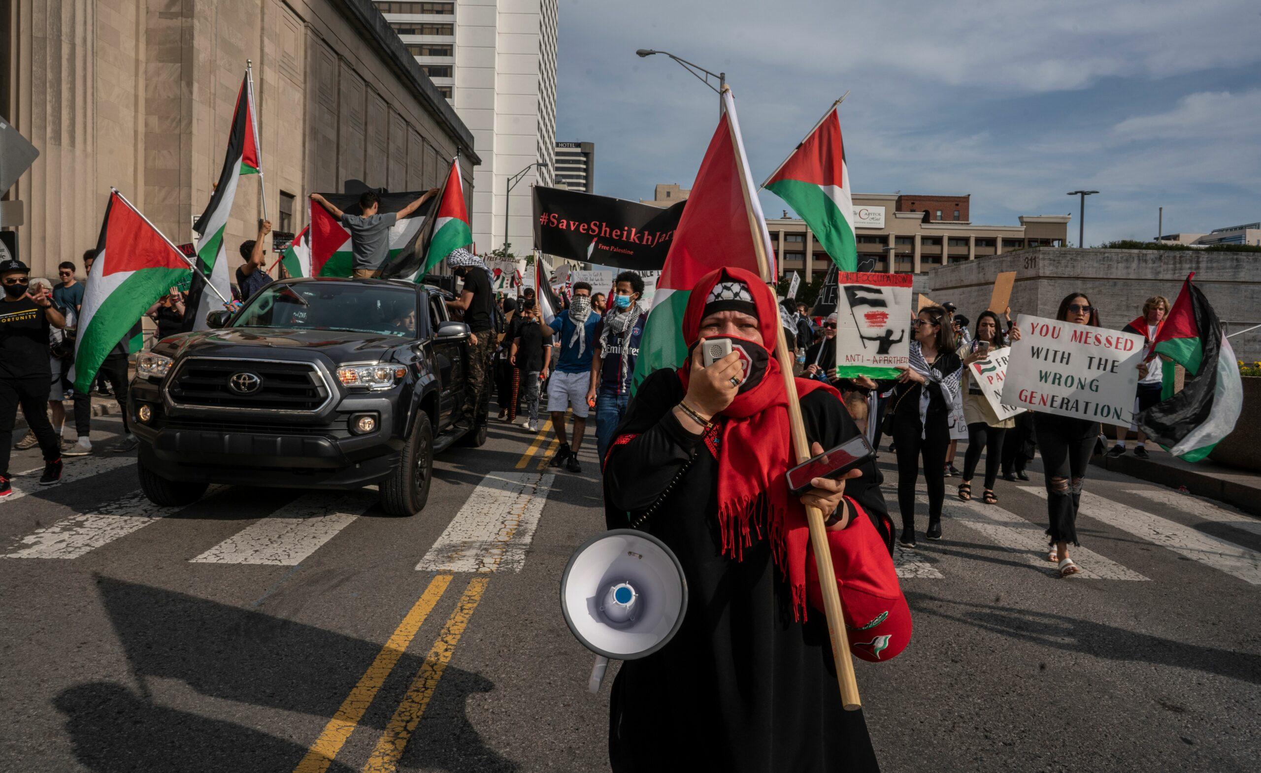 Eman Elmhaida leads the group of demonstrators on Friday. (Photo: John Partipilo)