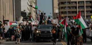 On Friday, a group of pro-Palestine demonstrators moves down Nashville's 7th Ave. en route to the Tennessee Capitol. (Photo: John Partipilo)