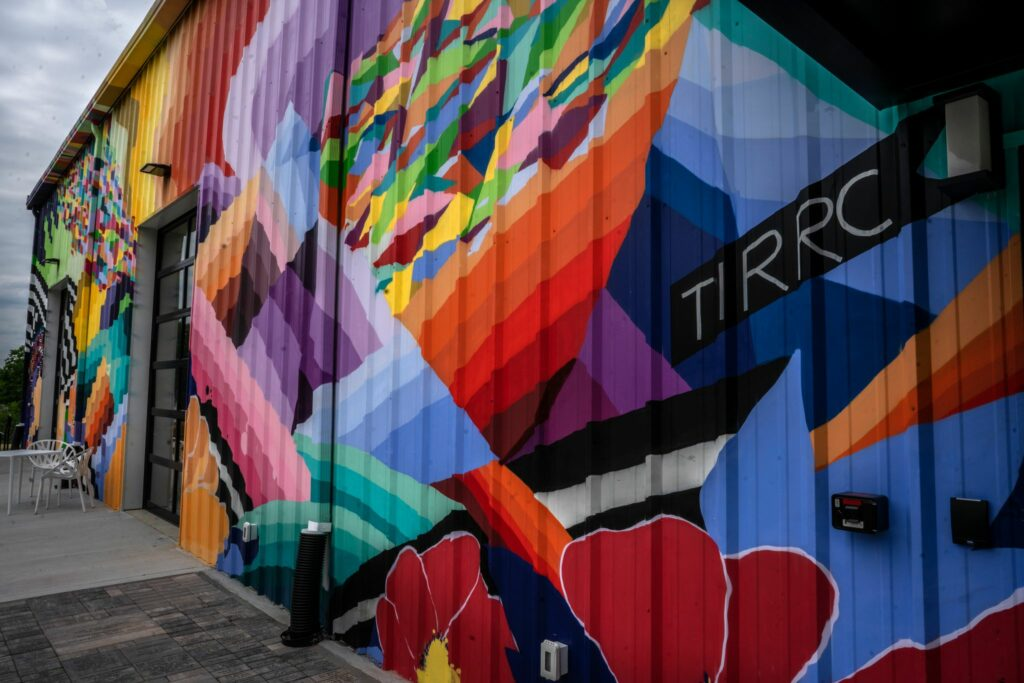 The exterior of TIRRC's new building explodes with colorful murals. (Photo: John Partipilo)