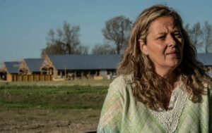 Monica Blankenship on her back patio, with scores of chicken barns rising in the background. (Photo: John Partipilo)
