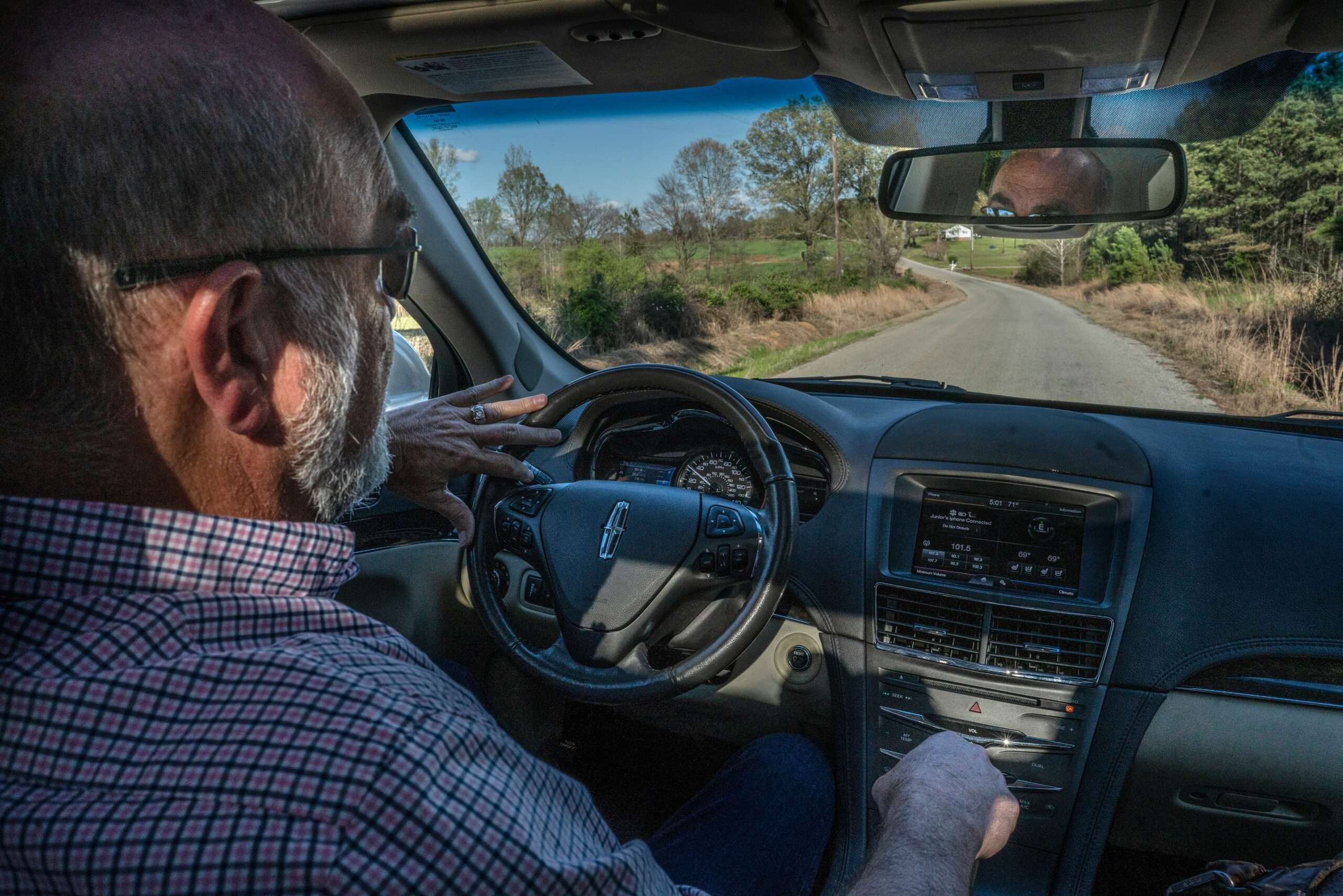 """Claude """"Junior"""" Johnson shows all the roads that the Tyson barns that will be too small for big trucks to transport chickens."""