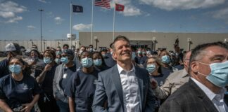 Gov. Bill Lee at a plant dedication Humboldt, Tennessee in March, pictured with plant workers. (Photo: John Partipilo)
