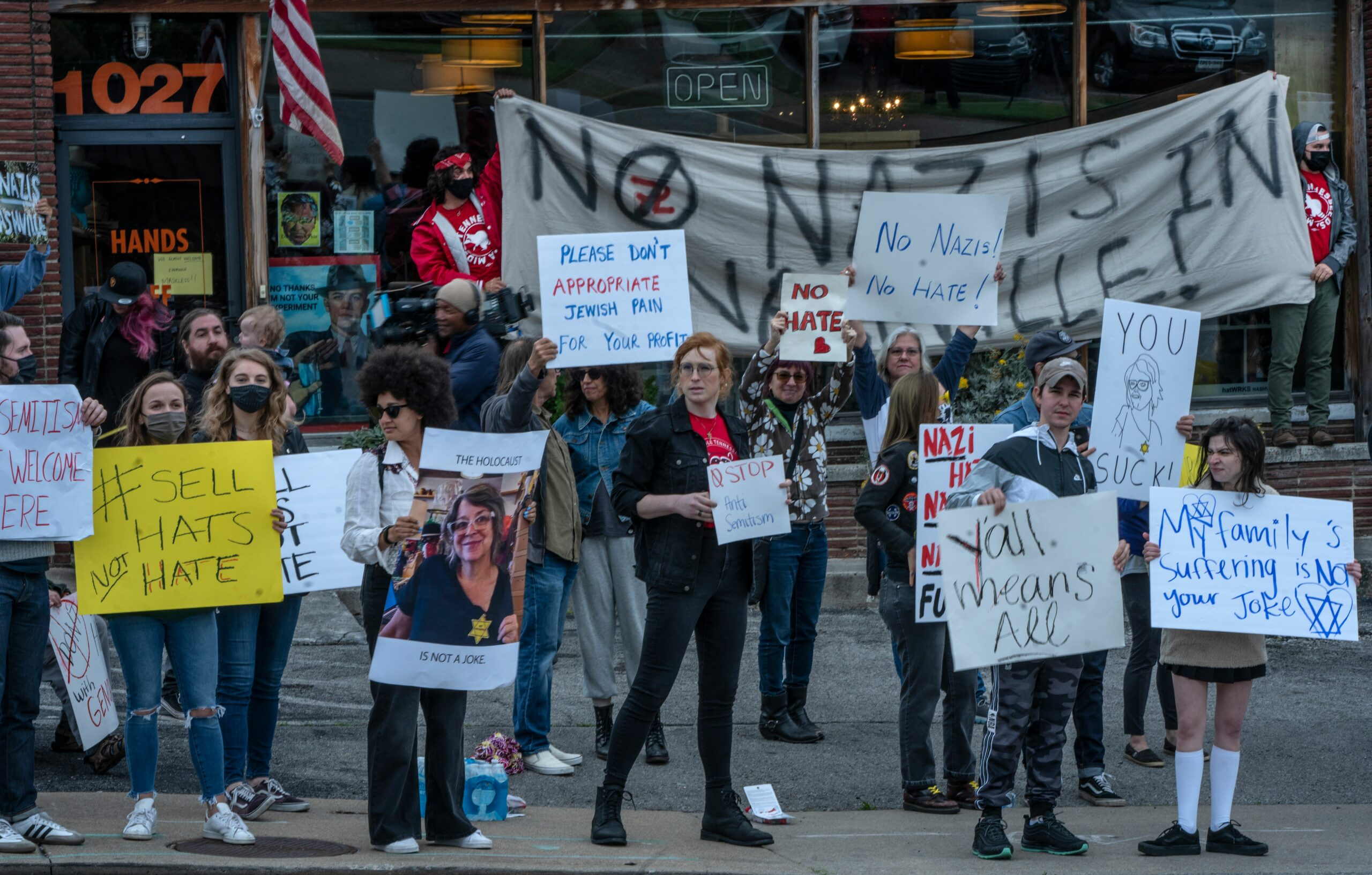 A crowd gathered Saturday in Nashville to protest outside Gigi Gaskins' store after she announced she would sell yellow Stars of David, similar to the ones Nazi Germany forced Jewish citizens to wear. (Photo: John Partipilo)