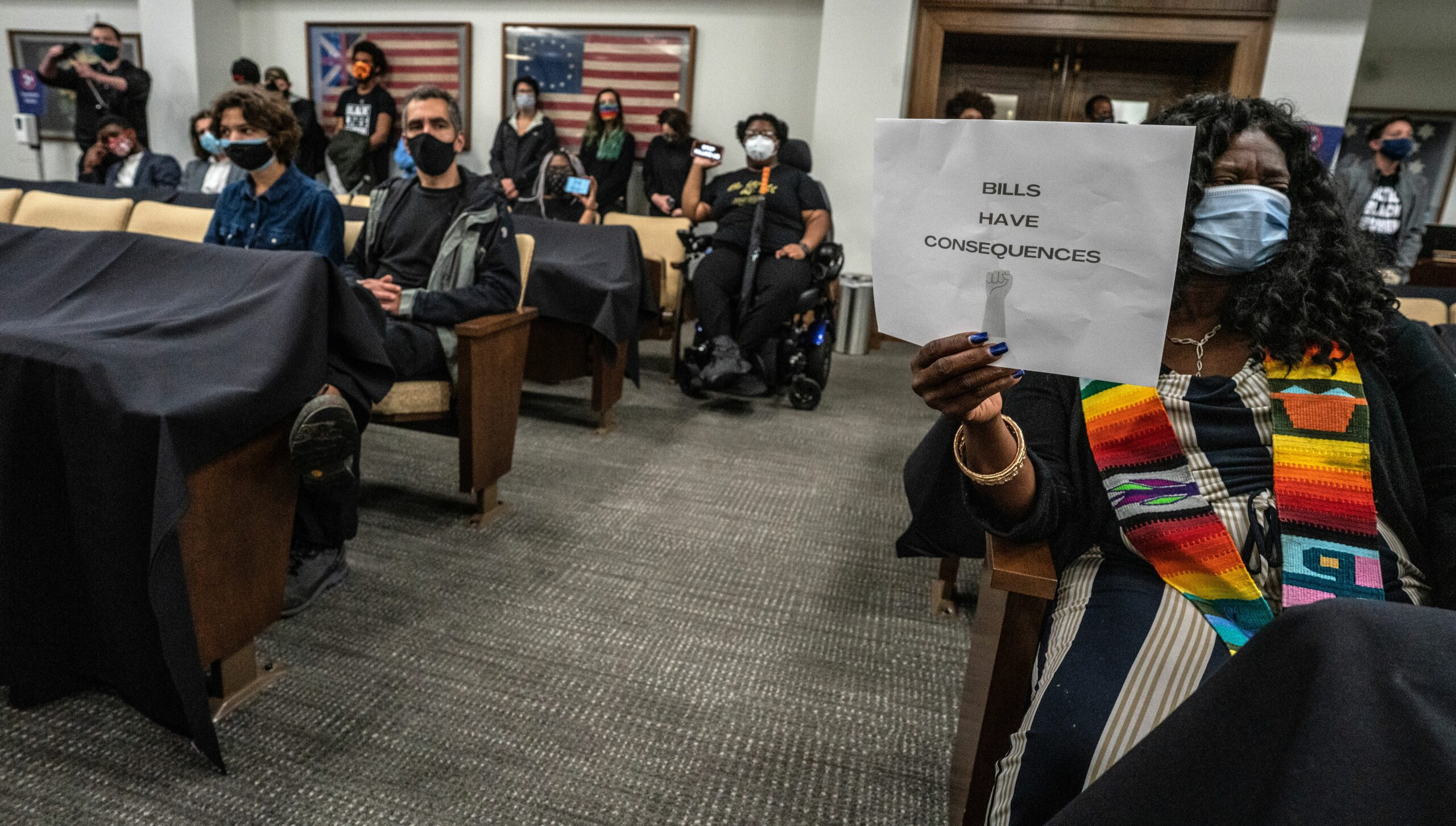 'Bills have consequences,' says a sign held by a Tennessee resident sitting in a Tennessee Senate hearing Tuesday. The hearing focused on a bill giving immunity to drivers hitting protestors and was one of several racially-charged hearings on what could be the final day of the legislative session. (Photo: John Partipilo)