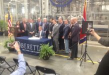 Flanked by legislative leaders, Gov. Bill Lee signs - for the second time -a law permitting permitless gun carry. (Photo: Sam Stockard)