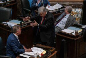 State Sen. Todd Gardenhire, center, talks with a colleague on the Senate floor. (Photo: John Partipilo)