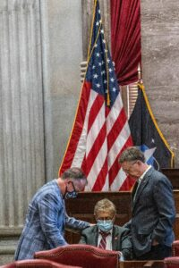 Rep. Mike Bell, R-Smyrna, at left, and Rep. Dan Howell, R-Cleveland, at right, pray over Rep. David Byrd. (Photo: John Partipilo)