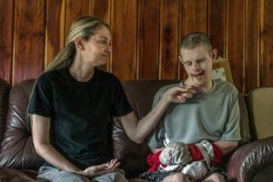 Drama sits with Jay, whose hands are wrapped so he can't injure himself. (Photo: John Partipilo)