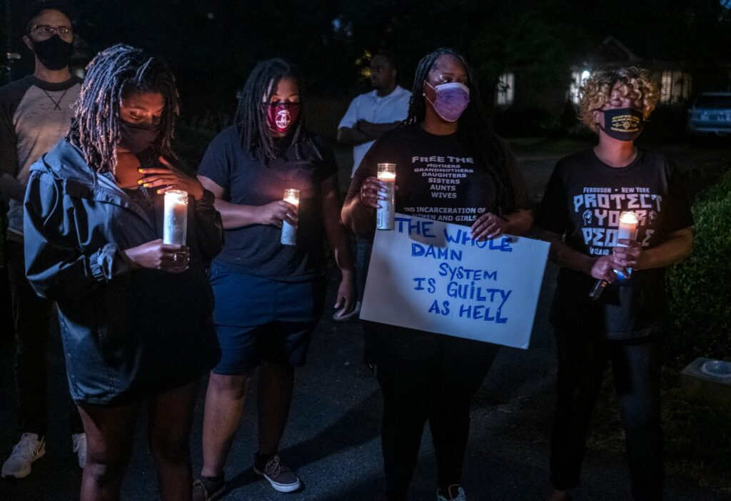 A group of people gathered outside Davidson County District Attorney Glenn Funk's house to protest his plea deal with former Nashville police officer Andrew Delke. (Photo: John Partipilo)