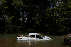 WAVERLY, TN - AUGUST 23: A partially submerged Ford F-150 sits in Trace Creek on August 23, 2021 in Waverly, Tennessee. Heavy rains on Sunday caused flash flooding in the area, leaving at least 22 people dead and several more still missing. (Photo by Brett Carlsen/Getty Images)