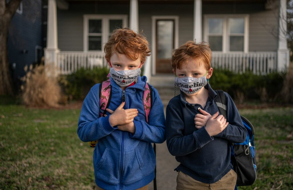 Twins Marshall and Charlie Groves prepare for school at Nashville's Lakeland Design Center. (Photo: John Partipilo)
