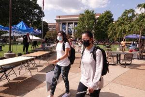 Masked students walk across the University of Memphis campus. (Photo: John Partipilo)