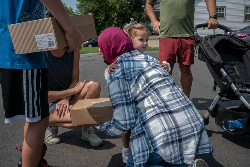 Poppy Thorne, age two and a half, hugs Jana Bahloul. Jana's father, Osama Bahloul, is imam at the Islamic Center of Nashville. (Photo: John Partipilo)
