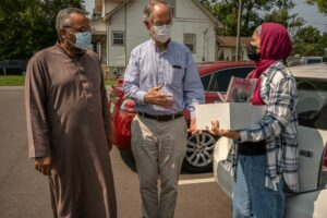 Congressman Jim Cooper, D-5th District, helps Iman Osama Bahloul and his daughter, Jana, gather supplies for Afghan refugees. (Photo: John Partipilo)