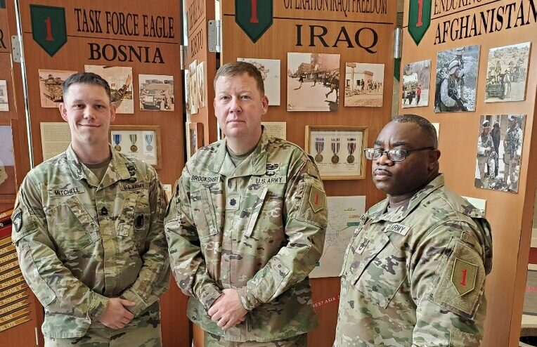 From left, Sgt. 1st Class Jason Mitchell, Lt. Col. Nate Brookshire and Sgt. 1st Class Clavon Barney, have between them more than 60 years of service in the military. On the anniversary of 9/11, they are remembering the day that spurred them to join or further their military careers. (Submitted by Fort Riley Public Affairs)