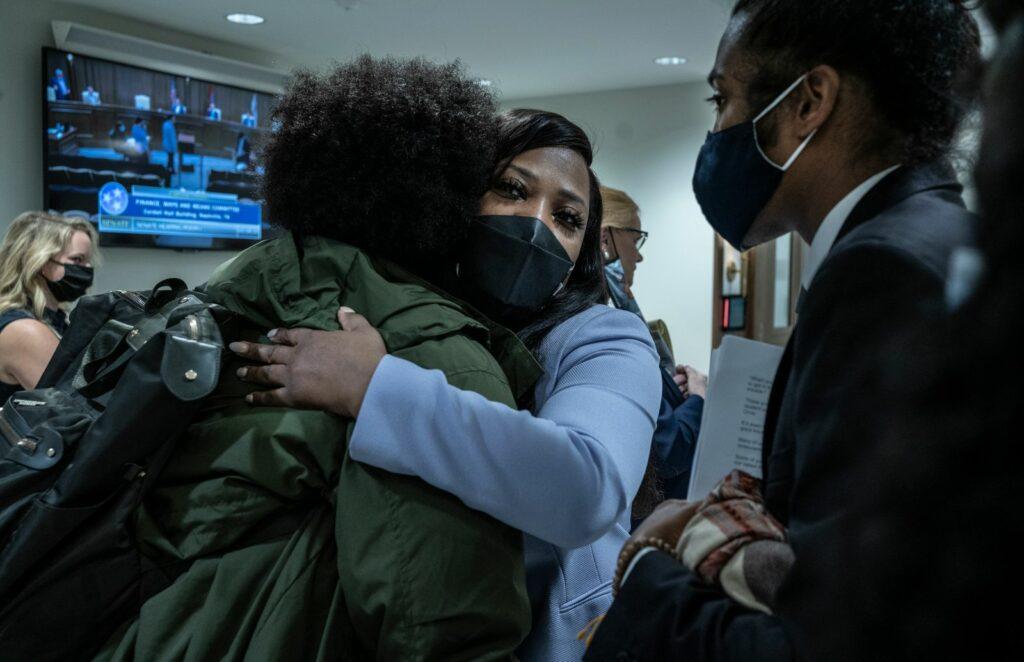 Sen. Katrina Robinson hugs a supporter in April during legislative session. (Photo: John Partipilo)