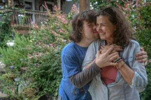 Joey Doherty hugs his mom, Tommi Stephenson, in the backyard of their Nashville home. (Photo: John Partipilo)