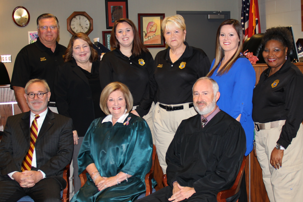 Rutherford County Juvenile Court Judge Donna Scott Davenport, in green judicial robes, pictured with other members of the juvenile court staff. (Photo: RutherfordCountyTN.gov)